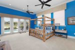 Enjoy the beach-themed bedroom, complete with a 55-inch SMART TV