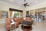 Gather as a family in the living room on the plush leather couches