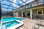 Step outside to a private screened-in pool area