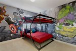 Kids can hang out with their favorite superheroes in this daring kids room