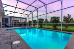 Admire the sunset while you swim in the privacy of the screened-in pool