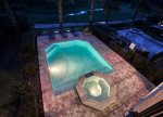 Exterior lighting allows for night swimming under the stars