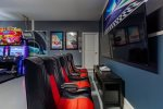Play an Xbox game while seated in one of the 4 gaming chairs