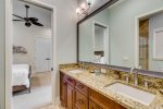 Jack and Jill bathroom has a dual vanity and a walk in shower