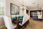The formal dining table has room for up to 8 guests