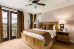 The second master suite has private balcony access and a king bed