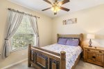 Quaint second master bedroom with queen bed