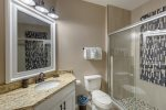 Luxurious master ensuite with mirrored vanity unit and double sized walk-in shower
