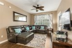 Enjoy the overhead ceiling fan and ability to walk out to your own patio