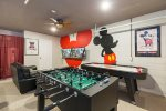 The game room features plush sofa, SMART TV, Xbox One, foosball, pool and air hockey table