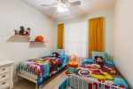 Whimsical kids themed room with two twin beds