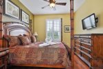 The overhead ceiling fan and king bed with be bliss