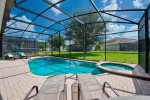 Lounge and soak in the Florida sun with the comfort of a screened in pool