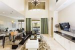 Contemporary furnished living room with wall mounted LCD TV
