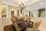 Stylish formal dining area comfortably seats six
