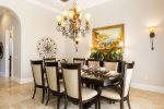 Formal dinner area with comfortable seating for 8