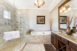 Master bath with oversized jet tub and walk in glass shower