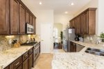 Fully equipped kitchen with granite countertops and stainless steel appliances