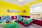 Kids bedroom features two twin beds