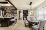 The kitchen has high end appliances and counter seating