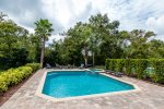 A sparkling crystal blue pool and palm trees await you on your Florida vacation