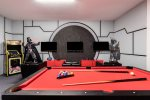 Fun awaits with this game room choose from a game of pool, air hockey or even foosball