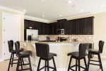 Comfortable bar seating for 5 around the breakfast bar