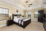 Master bedroom with a large flatscreen TV