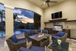 Gather around the fire in the comfortable conversation seating on the lanai