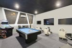 The ultimate games room with a 70-inch SMART TV, two 50-inch SMART TVs, Xbox One and PlayStation 4