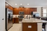 Upgraded kitchen with stainless steel appliances and granite counters