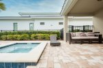 Soak up the sun in the loungers by your pool
