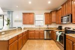This large kitchen with stainless steel appliances will make cooking a breeze