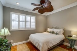 Second Bedroom has queen size bed, ceiling fan with lots of closet space