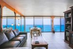 Enjoy relaxing in front of the TV with an ocean view.