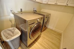 Dedicated laundry room with new high capacity washer \/ dryer