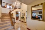Elegant entry with a beautiful staircase and crystal chandelier.