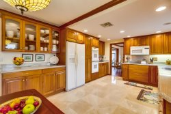 Spacious kitchen has everything you need for cooking and eating at home.