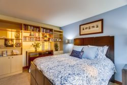 The downstairs bedroom has a queen bed and adjoining bathroom with walk-in shower.