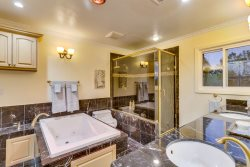 Spacious master bath w\/ two separate sinks and large bathtub