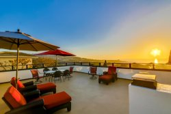 Enjoy beautiful sunsets on the rooftop deck