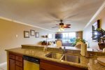 Kitchen has granite countertops and stainless steel appliances