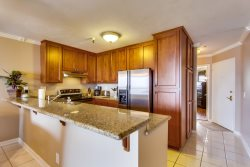 Lovely Cherry hardwood cabinets contain everything you need for cooking and dining at home.