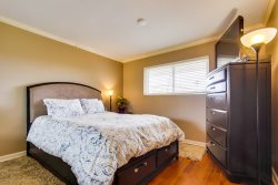 Bedroom has comfortable queen size bed with memory foam mattress and TV