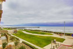 A great view of the beach and pier from the building complex