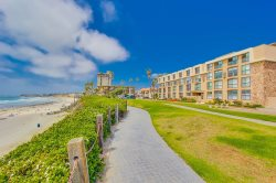 The building overlooking the boardwalk and ocean