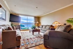 The living room with a gorgeous view of the ocean and boardwalk