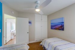 The second bedroom has two extra long twin beds plus a single roll out trundle bed and ceiling fan