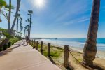 The Pacific Beach/ Mission Beach boardwalk is just steps from the building.