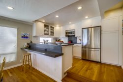 Newly renovated kitchen with new stainless appliances and quartz countertops